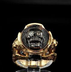 Medieval revival memento mori skull and angel artful diamond ring. £2,350.00, via Etsy.