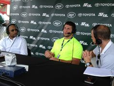 Tim Tebow sitting with Stephen A. Smith & Ryan Ruocco at Jets training camp (July 30, 2012)