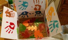 "Thanksgiving theme care package box, ""hands of Thanks""painted on and fall leaves at the bottom. Little notes of love and thankfulness throughout."