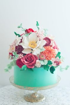 4. Talk about over the top! This uh-mazing aqua floral cake byLulu's Sweet Secretshas us in a visual frenzy with it's unbelievable array of EDIBLE flowers on top and gorgeous aqua color.