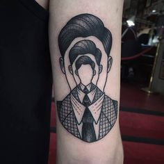 Awesome optic illusion like black ink man portrait tattoo on arm