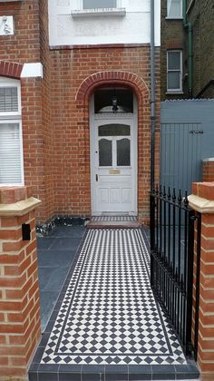 red imperial london brick wall blue black slate paving black and white victorian mosaic tile path metal rail and gate (1)