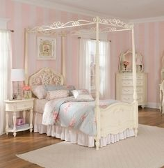This reminds me of my childhood room.  Shabby chic, Laura Ashley bedding, vintage canopy bed
