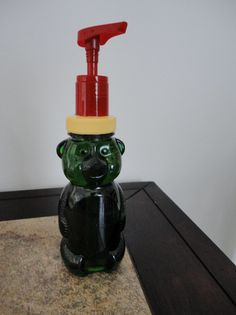 Honey bear (we call it gummy bear soap) soap dispenser. Save a pump from an old soap dispenser or lotion bottle. Cut a small hole in the lid so the pump will fit. I hot glued the pump on but other glues will probably work too. I used a craft/utility knife to cut the hole in the lid. This is a Bath and Body Works soap pump, a smaller one would look better.