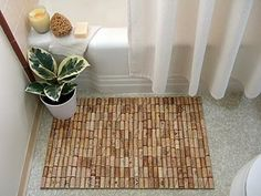 One of a myriad of diy projects to make with wine corks - an awesome bath mat!