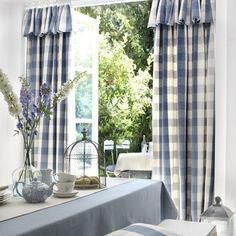 Clarke and Clarke -  Country Linens Fabric Collection - Blue, white and grey checked curtains with ruffle detail, blue tablecloth, white runner, blue/white crockery, birdcage style food protector