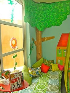 Indoor quiet spaces for young children.  I need to rethink our quiet space at home... it became a playdough/art space!