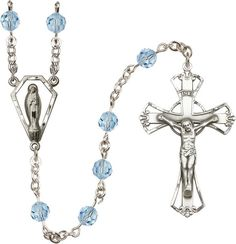 Sterling Silver Rosary features 6mm Alexandrite Swarovski beads. The Crucifix measures 1 3/4 x 1 1/8. The centerpiece features a Miraculous medal. Each Rosary i