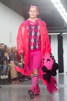 Sibling created pink punk looks with animal toys as part of their Fall Winter 2015.16 menswear collection presented at this year's London Collections: Men.