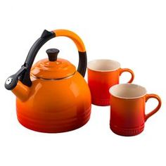 """Perfect for enjoying morning Earl Grey or evening chamomile, this 3-piece tea set features a sophisticated enameled steel design.  Product: Kettle and 2 mugsConstruction Material: Enameled steel and stonewareColor: FlameFeatures:  Anti-slip handle1.75 Quart kettle capacityDimensions: 15"""" H x 8"""" Diameter (kettle)Cleaning and Care: Can be used on heat sources such as gas, electric, induction and ceramic. Hand wash kettle. Mug is dishwasher safe"""