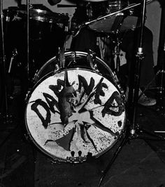 The torn and painted bass drum head belonging to the kit of Rat Scabies from English punk band The Damned seen during a gig at the Hope & Anchor pub in Islington, London