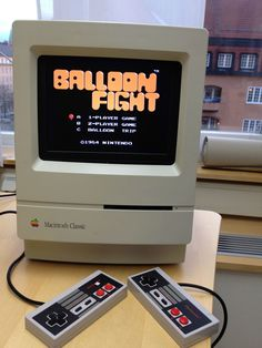 Some guy built a small NES arcade machine out of a Macintosh Classic, a Raspberry Pi and some NES controllers. Awesome