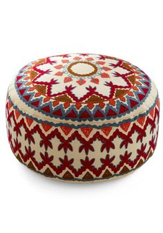 Embroidered pouf/ottoman. These colors would look right at home in a few rooms I can think of.