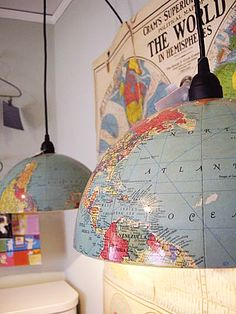 See the world... Or perhaps the world can help you see, being repurposed into overhead work lamps.