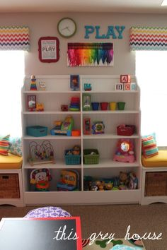 Our Bright and Fun Playroom: The Details | love everything about this bright playroom!! Especially the rainbow window valances!