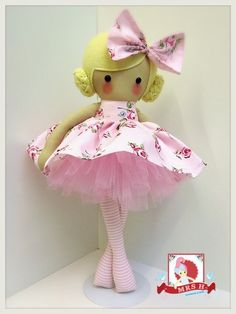 """This dolly is 19"""" tall and wears a removable skirt and tutu that gives off the look of a dress.  She is made to order and will take approximately 2-3 weeks.  This dolly comes as pictured but..."""