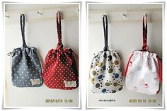 Reversible dog treat drawstring pouch with handle