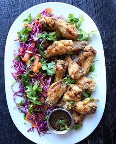 Lets be real its to 'effing hot to cook. But in case youre not using Seamless Honey Cilantro Wings with Red Wine Vinegar Slaw. @Delish #recipe link in profile. #thejudylab #howisummer