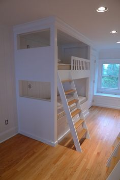 Storage under the bunks, or pull out beds for more kiddos! Love the window seat in the middle.