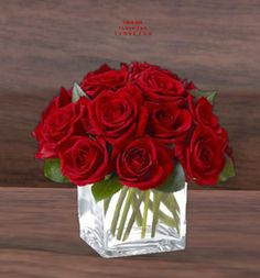 short square vase with red roses, and I will add berries and pearls in flowers