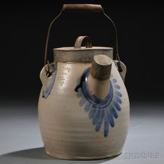 "Cobalt-decorated Batter Jug, Theodore Gustav Daub, Easton, Pennsylvania, c. 1870s, 1 1/2-gallon jug with applied wire and hardwood handle, original tin cover and spout cover, with cobalt-highlighted area around spout and handle loops, impressed maker's mark ""T.G. DAUB EASTON PA."" on shoulder, overall ht. 11 1/4 in."