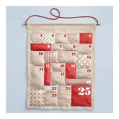 i would love to have a plush advent calendar to hide tiny gifts and sweet treats in for ben! what a lovely little tradition :) now just to find the perfect one! this one is nice, but not THE ONE (land of nod - $35)