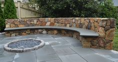 Exterior:Cool Outdoor Patio Design Using Curved Stone Bench And Round Inground Fire Pit With Concrete And Landscaping Terrific Outdoor Patio Design for Lounge Space Backyard Ideas