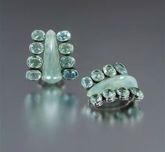 A Pair of Silver, Green Beryl and Grey Chalcedony Dress Clips, Suzanne Belperron. Estimate $30,000-50,000