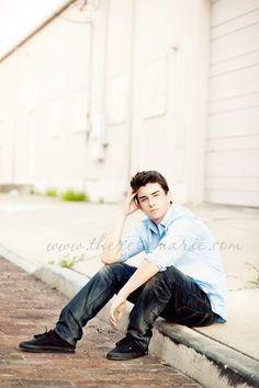 High school senior boy in Tarpon Springs florida posing for Senior Pictures
