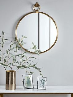 Crafted in a simple, circular shape with a wide mirrored surface and ribbed solid brass frame, our unique. mirror will enhance the warmth and light in your living space and add interest to any wall. Each piece features a large hook to be mou Wall Mirrors Uk, Mirrors And Marble, Hallway Mirror, Unique Mirrors, Vintage Mirrors, Living Room Mirrors, Window Mirror, Unique Doors, Bathroom Mirrors