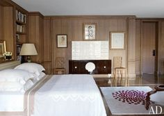 Designer Jacques Grange installed oak boiserie trimmed with gold leaf in the master bedroom of a London townhouse. The André Groult ivory-and-Macassar-ebony chest of drawers once belonged to the Vicomtesse de Noailles, and the chairs are by Jean-Michel Frank | archdigest.com