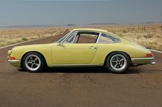 This golden green 1967 Porsche 911 is a non matching color change car and is one of the 200 sunroofs produced in 67. It has a Rebuilt 2.7motor on a 2.4 7R 73T case.