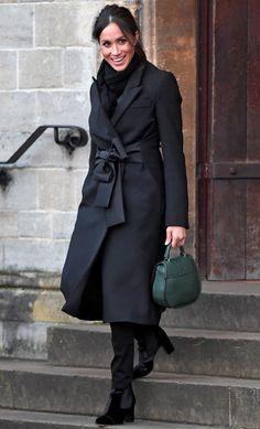 Meghan Markle in a black wrap coat, Demellier London bag, black pants and boots