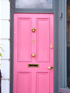 pink door with bee door knocker magenta pretty city