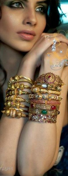 Jewellery Gold bracelet stacks by Nadia Chhotani .