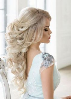 pulled back curly wedding hairstyle for long hair via elstyle / http://www.himisspuff.com/wedding-hairstyles-for-long-hair/2/ #weddingmakeup