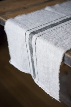 These beautiful flax table runners are handmade with a rich, rustic, washed linen that has a soft look and feel...both edges are frayed and each end has a subtl