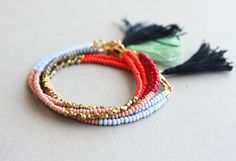 Beaded Friendship Bracelet Tassel Bracelet by feltlikepaper, $26.00 | This is so easy to DIY and they look soooo lovely!!