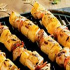 Grilled Chicken, Plantain and Pineapple Skewers - This grilled kabob recipe pairs the rich, flavorful thigh meat of the chicken with strips of bacon, plantains and sweet, fruity pineapple.