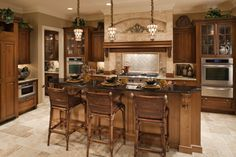 Traditional kitchen designs with dark wood cabinets