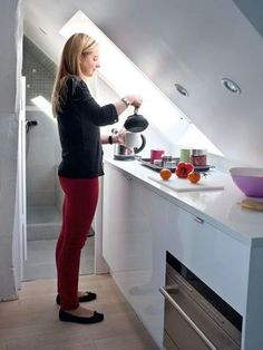 Unused space under the roof was converted into a 170 square foot apartment by French architect Sylvie Cahen