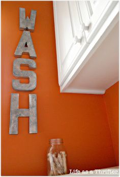 Cool, cheap idea for the Laundry Room. ** UPDATE 2/21/12: Made these letters for my laundry room & hung them in a similar spot as in the picture - looks cool! Only thing I did differently was to spray paint them first, then cover the fronts in scrapbook paper in coordinating colors as my laundry room, modpodged & sprayed with clear gloss spray paint. Nice way to warm up the Wash Room :)
