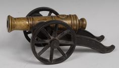 A large 19th century brass and cast iron model cannon