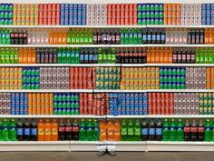 """""""The Invisible Man""""   Liu Bolin is a Chinese artist who uses his body and paint to blend into backgrounds. This is just 1 of 20 photos in the gallery!"""