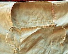 This replica also has a square neck opening with overlapping flaps in front to seal out cold weather. The flaps are held shut with cords and loops (right).