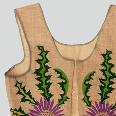 Womans bodice of grey linen. Decorated with embroidery. Trimmed with grey tape. At the front edges eyelets to tie the bodice with ribbon. Machine-sewn.  Podhalanian Highlanders, Maruszyna, P. Nowy Targ, early 20th c.