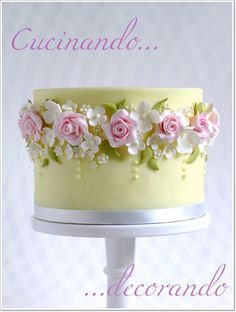 yellow cake with pink roses