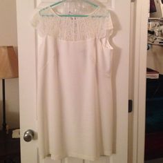 """Lace sleeve cocktail dress Worn only once to my rehearsal dinner. Has a very small yellow spot on the front that will come out when dry cleaned. Keyhole back and lace cap sleeves. Very pretty and flattering! Perfect for holiday parties! Dimensions: 34"""" long top of back to bottom hem, 16"""" across the back, 21"""" across bust when laid flat, 19"""" waist when laid flat. Lined entirely except for lace parts. White House Black Market Dresses Mini"""