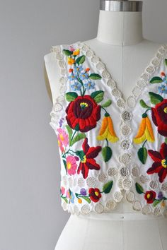A rare find! Antique 1930s hand made Kalocsai waistcoat fully decorated with colorful thick embroidery and open work lace. Large snaps have been added