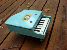 Antique Wooden Baby Blue Toy Piano 1950s. via Etsy.